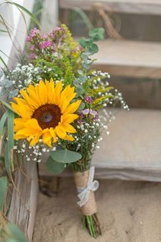 A sweetly rustic bouquet of sunflowers and baby's breath | Photo by T. Y. Photography