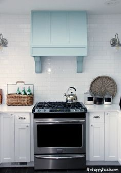 Adding Corbels to a DIY Wooden Range Hood Fan at thehappyhousie.com