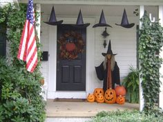 Halloween front door decor. I really like this witch and carved pumpkins for the front door.