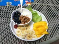 Post run lunch! Greek yogurt with blueberries and a little bit of Kind granola, half a banana, some mango and honeydew melon