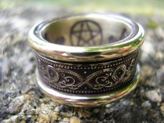 A regal ring of Golden Serpents with Secret Runes and Pentacle in 9 ct Gold by Jason of England.