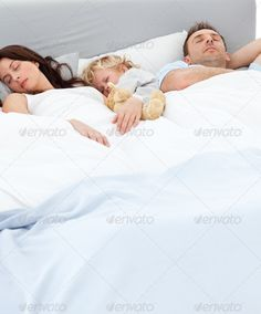 Cute little boy sleeping with his parents ...  Repose, asleep, beautiful, bed, bedroom, calmness, catnap, caucasian, comfort, couple, doze, dream, family, father, handsome, happiness, happy, healthy, home, kip, lifestyle, little, love, lying, man, married, morning, mother, nap, pajama, peace, pyjama, quiet, quietude, relationship, relax, relaxation, relaxing, resting, serene, serenity, siesta, sleep, slumber, snooze, son, tranquil, tranquility, weekend, woman