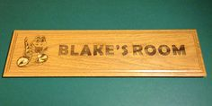 "How would your child like to see their name and favorite thing engraved on a personalized sign for their bedroom or other special place?   Custom signs are up to 24"" long and are engraved on reclaimed wood. You tell us what color and style you're interested in, your child's name, and any image or saying you'd like to go along with it. We'll do the rest!"