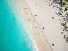 Cheaper art via Shutterstock  Tropical Beach from Above for The Design Confidential Artistic Appeal Wet + Wild Edition