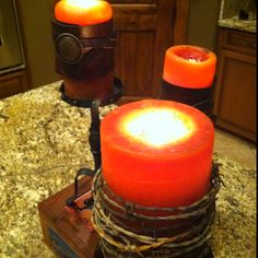 Barbed wire and leather on candles.