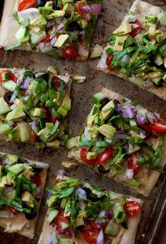 Greek Salad Pizza - Red Onion, Avocado, Tomato, Cucumber, Hummus,, Basil, & Pita