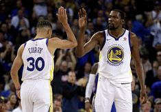 Scoring Basketball Academy - Golden State Warriors Stephen Curry, left, and Kevin Durant (35) celebrate a score against the Philadelphia 76ers during the second half of an NBA basketball game Saturday, Nov. 11, 2017, in Oakland, Calif. Warriors won, 135-114. (AP Photo/Ben Margot) - TSA Is a Complete Ball Handling, Shooting, And Finishing System!  Here's What's Included...