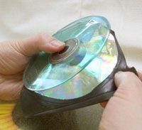 who knew you could remove the holographic film from a cd-r and craft with it??? Cool tutorial for hair barretts.