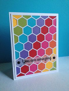 handmade card ... hexagon die plate cut in white ... background filled in diagonal stipes in rainbow array ... bright and beautiful card ... like the sentiment stamped on vellum on top  ...