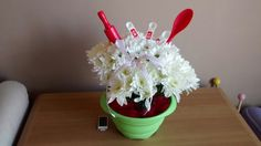 Floral display with cooking utensils in colander!