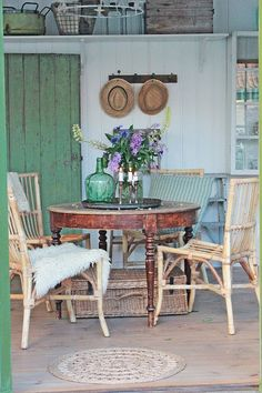 Vintage dining table, bamboo chairs. Casual rustic.