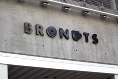 Logotype and exterior sign design for coffee and donuts caffe Bronuts byOne Plus One
