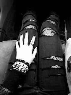 Slashed jeans over tights