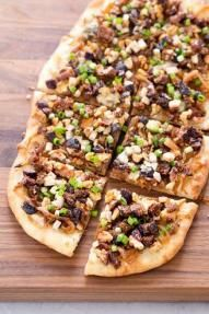 Rustic Caramelized Onion Tart with Figs, Turkey, Blue Cheese and Walnuts recipe! These tarts are not made in a tart pan; instead they are baked free-form for a rustic appearance.