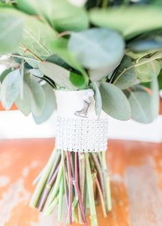 This unique ice skate wedding bouquet accessory was featured in a real wedding from Virginia Beach, Virginia. Visit WeddingWire for wedding bouquet accessories and florals for your own wedding. Planning your wedding has never been so easy (or fun!)! WeddingWire has tons of wedding ideas, advice, wedding themes, inspiration, wedding photos and more. {Delandra Brokaw} Wedding Themes, Wedding Photos, Wedding Ideas, Wedding Day Jewelry, Wedding Accessories, Virginia Beach, On Your Wedding Day, Wedding Bouquets, Real Weddings