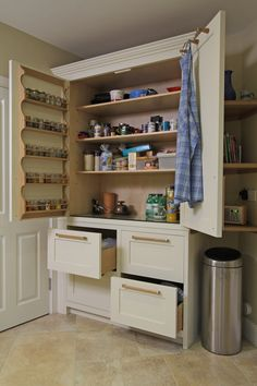 Oak and Painted Wimborne Kitchen in Cream and Blue with Natural Oak: Another picture from our most recent install. This one shows the bespoke larder unit. This was specially made to fit an unusually shaped part from the room. Lots of deep shelf storage, plus handmade spice racks and deep full length drawers.