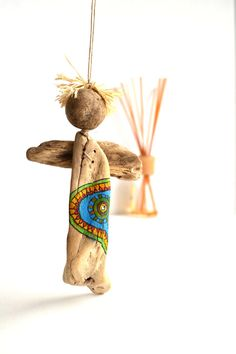 Driftwood Angel decorated with acrylic paint by Grazim on Etsy, $20.00