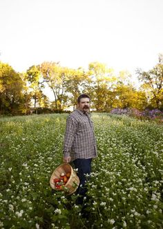 Capitol Grille's Chef Tyler Brown harvesting vegtables for his daily farm-to-table menu