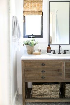 Neutral bathroom design with white and warm woods | Mindy Gayer Design Co.