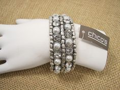 Only $22.99 with free shipping! Chicos Pearl Charm Rhinestone Silver Tone Stretch Bracelet MSRP $24.95 #Chicos #Statement