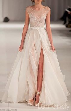 Scoop cap sleeves split A line organza by Lemandyweddingdress, $288.00 from Etsy. A risk, sure. But the maker has great reviews...
