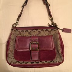 Rare Coach Handbag Rare authentic Coach small shoulder bag. Beige and burgundy. The burgundy part is suede. One front pocket with magnetic closure and one large interior zippered pocket. Brass hardware. Beautiful bag, never used. No marks or scuffs on the interior or exterior of bag. It measures 11 inches across, 8 inches in height, and 3 inches wide. Definitely a rare find  Coach Bags Shoulder Bags