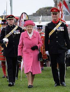 On May 2, the day of Charlotte's arrival, Queen Elizabeth wore an all-pink ensemble as she attended the amalgamation parade of the Queen's Royal Lancers and 9th/12th Royal Lancers. The color choice was seen as a way to celebrate the birth of her granddaughter.