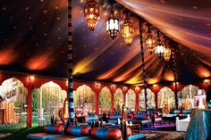 The Grand Marakesh from Raj Tents is a by Moroccan-theme tent that includes arches and silk string drops on all openings, a full. Photo: Courtesy of Raj Tents
