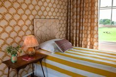 An English bedroom with Seaweed Lace Wallpaper - Indian Yellow by Soane Britain. Yellow Interior, Interior And Exterior, Lace Wallpaper, Luminaire Mural, Interior Design Inspiration, Daily Inspiration, Soft Furnishings, Furniture Making, Decoration