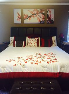 Cherry blossom master bedroom with padded headboard and padded bench at the foot of my bed.