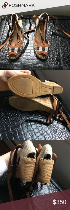 Never worn plaid Burberry wedge espadrilles These have never been worn, real Burberry(the front has the cute plaid) wedge espadrilles! Not ripped, stained or worn AT ALL!! Great deal...size 39(euro so 9 us) but they actually run small so would def fit 8/8.5-DEFINITLEY! Burberry Shoes Espadrilles