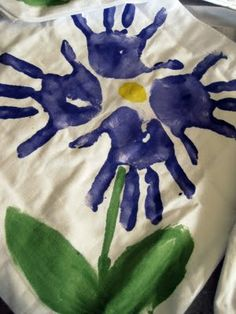 Mothers Day gift from students-linen bag with hands that make a flower- maybe kids could write a message for their mom on the bag too!