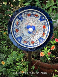 Plate flower with vintage cobalt blue plate by Garden Whimsies by Mary