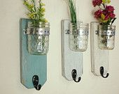 Shabby chic hanging wall vase sconce- Industrial chic- beach decor- decorative bottles- in Turquoise. $40.00, via Etsy.