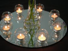 Mirror Plates and Candles for hire