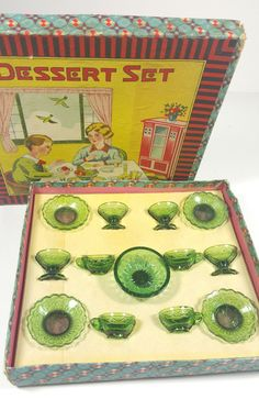 Adorable green glass tea set for your dolls, still includes the adorable box as well! Box is a little rough in some places. All of the corners