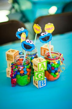 Center pieces I made with canning jars and peanut M&M's. The Cookie Monster sticks are glued on a straw