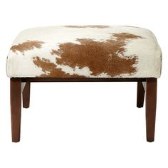 with its adventurous blend of brown and white hair on hide, leather and wood, the wordsmith ottoman is ideal for long hours of relaxing. through the