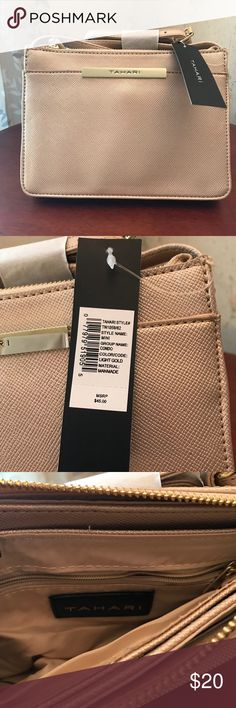"""TAHARI condo minibag Tahari condo minibag offers a button clasp pocket in the front, zipper opening, and one zipper pocket in the interior. Also has a 24"""" drop. Dimensions: 6.5""""H x 8.5""""W x 1.5""""D  This item is brand new. I won it but it's not my style (rather have won the wine basket 😉)  I researched online and they're going for $20 so that is what I am asking. The original price on the tag is $45 but was probably purchased for a little less (coupon, sale, etc) Tahari Bags Shoulder Bags"""