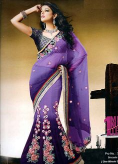 Trendy and comfortable ready to wear saree in designer collection will definetly give you the style statement. This is Purple Net, Brocade One Minute Saree with BlouseAn imposing of designer patch work & border flaunts it. It has Brocade blouse. The unstitched matching blouse material can be customised as per the requirement limited to availability of material. Available blouse material length is 80 cm. Slight variation in color or patch may be possible due to photography effect.