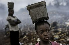 In an e-waste dump that kills nearly everything that it touches, Fati, 8, works with other children searching through hazardous waste in hopes of finding whatever she can to exchange for pennies in order to survive