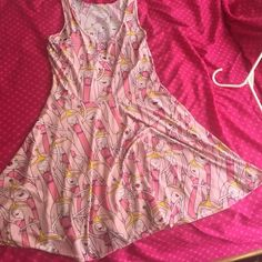 Princess bubble gum dress. Never worn Pink Princess Bubble Gum for all those Adventure Land fans. Bought at comic con convention. Never worn! Fits So comfy. Elastic material. Small or mediums can fit this Dresses