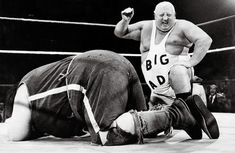 big daddy versus giant haystacks...Grandad loved the wrestling...and loved to get you into a headlock until you 'submitted' lol