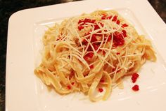 Blackened Chicken With Sun Dried Tomatoes With Romano Cream And Butter Sauce Tossed Into Fettuccine Noodles