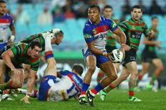 Travis Waddell of the Knights pases during the round 12 NRL match between the South Sydney Rabbitohs and the Newcastle Knights at ANZ Stadium on June 1, 2013 in Sydney, Australia.