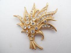Swarovski swan signed feather bouquet brooch gold tone and rhinestones AA822 by MeyankeeGliterz on Etsy