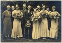 Vintage wedding group photograph. Sitters unknown.