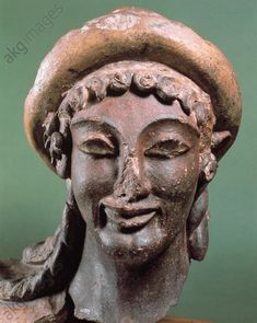 HERMES OF VEII / ETRUSCAN SCULPTURE. Etruscan sculpture, c. 500 BC.  Hermes of Veii.  Head of a figure from the roof-ridge of the temple at Portonaccio. Terracotta.