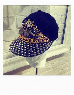 River Island Cap  http://www.company.co.uk/high-street-edit/off-the-rails/diary-of-a-fashion-intern?page=21