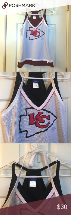 Kansas City Chiefs top Super cute Chiefs top.  Jersey material, racerback plus halter.  Excellent condition.  Probably my favorite Chiefs top but unfortunately it's too small and hanging in the closet. Reebok Tops